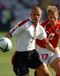 David Beckham and Christoph Spycher concentrate on the ball